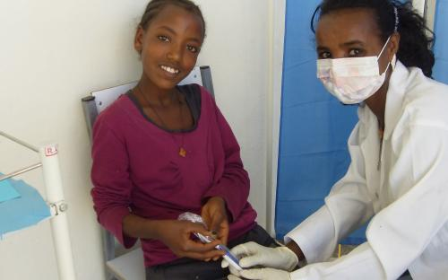 A Dentist Giving A Patient A New Toothbrush